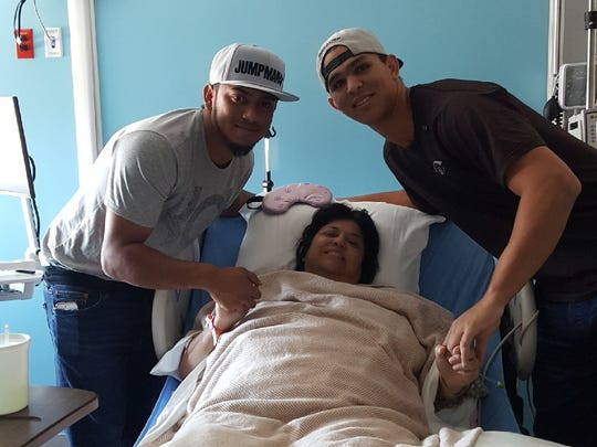Detroit Tigers top prospect Franklin Perez, right, and Houston Astros prospect Arturo Michelena visit with Gloria Vargas, who teaches English to Astros minor leaguers, after she was injured in a car accident. Perez was traded to the Tigers in the deal that sent Justin Verlander to Houston.