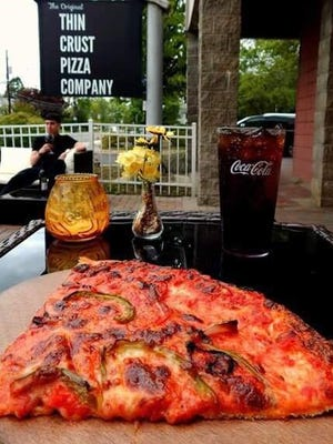 The Original Thin Crust Pizza Company has brought back the famous upside-down pizza from Pete's Bar.