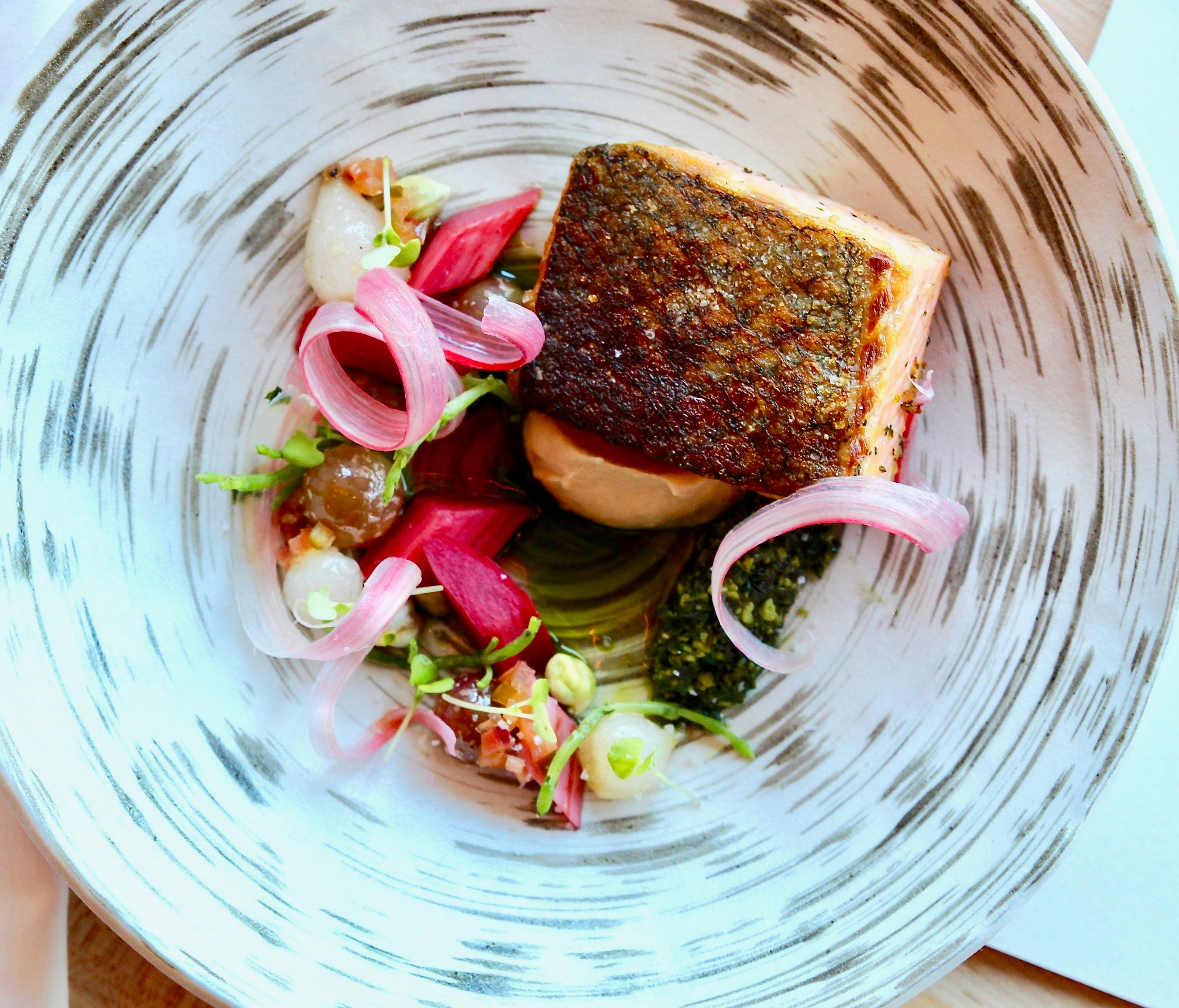 Guild head chef Sterling Ridings serves seasonal fare with an emphasis on seafood, such as Atlantic Salmon with muskat grape, smoked shallot soubise and rhubarb in the spring.