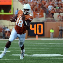 Sep 6, 2014; Austin, TX, USA; Texas Longhorns quarterback Tyrone Swoopes (18) scrambles against the Brigham Young Cougars during the first half at Darrell K Royal-Texas Memorial Stadium. Mandatory Credit: Brendan Maloney-USA TODAY Sports