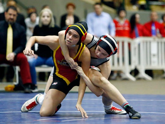 Robin Yunis of Rossview competes with Helena Campbell of Science Hill during the TSSAA Individual Wrestling State Championships finals, Saturday, Feb. 17, 2018, in Franklin, Tenn. (Photo by Wade Payne, Special to the Tennessean)