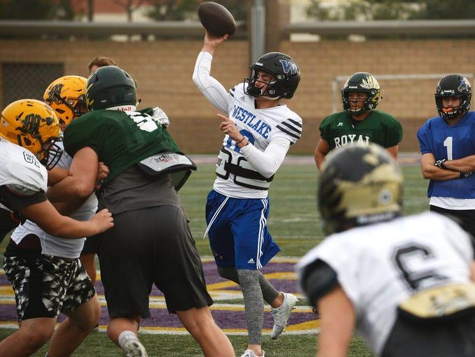 Westlake High quarterback Jake Kaplinaki throws a pass