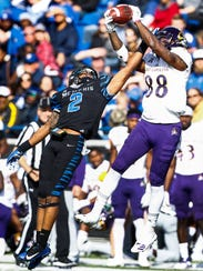 ECU receiver Trevon Brown (right) grabs a pass while