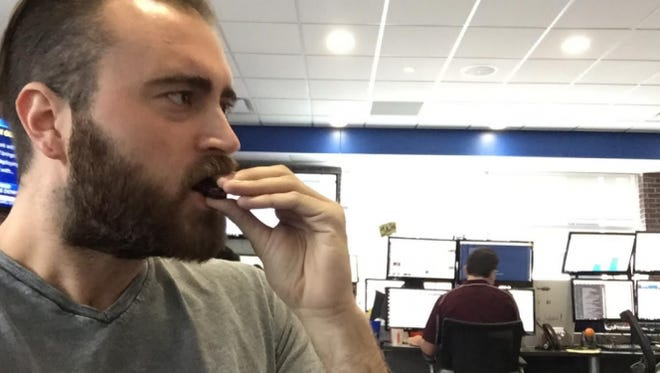 Benzinga reporter Spencer White tries a new Swedish Fish flavored Oreo cookie.