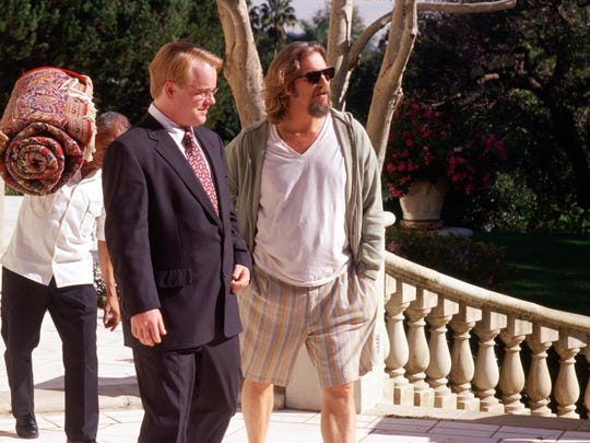 "Philip Seymour Hoffman, left, and Jeff Bridges, right, appear in a scene from ""The Big Lebowski."""