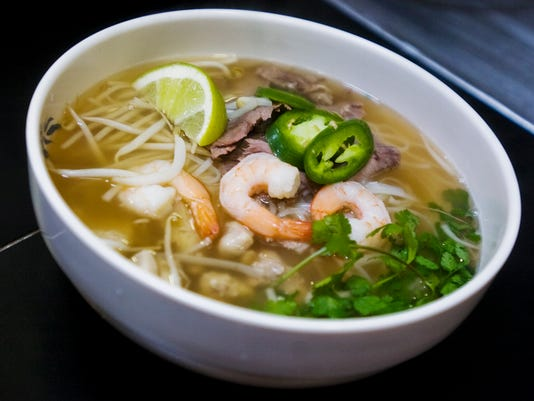 Starting a meal with soup like this shring pho noodle soup helps fill you up. Shane Dunlap - The Evening Sun