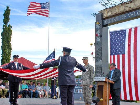 A 10-foot I beam from the World Trade Center was used in the Court of Valor Memorial at Prospect Hill Cemetery in York. Fourteen years after terrorists destroyed the center, most of the relics have been distributed across the country for use in memorials and museums. In this file photo,  Douglas Howard, left, and Donald Newcomer fold a flag in honor and memory of Chief Rodney Miller, Loganville Fire Co., during the Court of Valor 2013 Ceremony at Prospect Hill Cemetery..