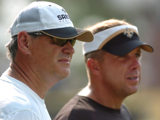 New Orleans Saints General Manager Mickey Loomis (left) and head coach Sean Payton watch a practice.