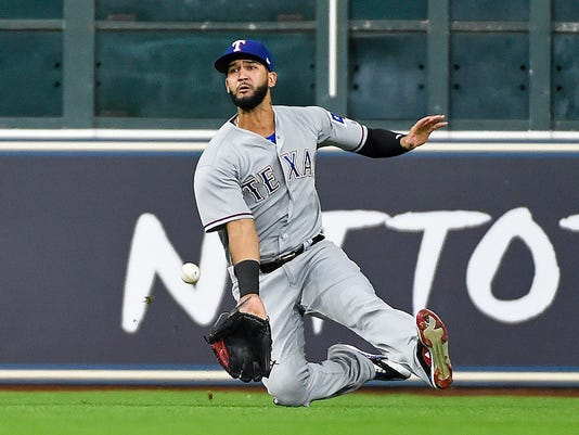 Texas Rangers right fielder Nomar Mazara fails to catch the line drive of Houston Astros' Alex Bregman during the fifth inning of a baseball game, Monday, June 12, 2017, in Houston. Carlos Beltran scored on the play. (AP Photo/Eric Christian Smith)