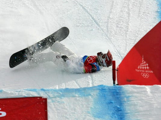 FILE - In this Feb. 17, 2006 file photo American Lindsey Jacobellis who was leading in the final of the Women's Snowboard Cross competition, crashes in sight of the finish at the Turin 2006 Winter Olympic Games in Bardonecchia, Italy.  Jacobellis says she's long since moved past her misstep that cost her a gold medal at the 2006 Olympics. Jacobellis was leading in the women's snowboardcross finals when she fell after trying to showboat a bit on her way to the finish line. The mistake forced her to settle for silver. (AP Photo/Lionel Cironneau)