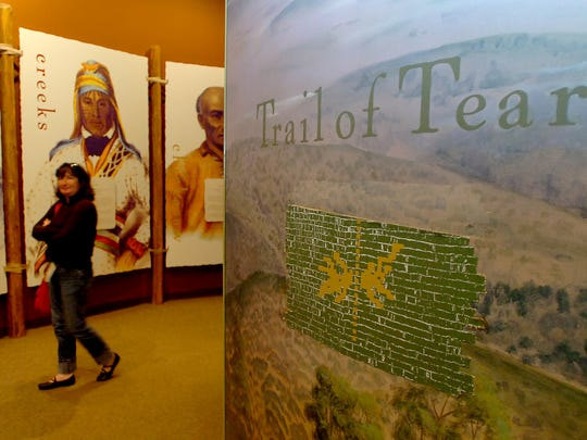 Rita Grazi walks through the Trail of Tears exhibit at the Museum of the Cherokee Indian.