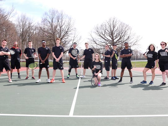 The Harding 2015 varsity tennis team is, from left Ryder Delavern, coach Russell Collins, Cable Oldfield, Win Adissem, Jacob Lester, Cain Lackey, Parker Baird, Anne Charvin, Robby Stoneburner, Colin Hart, Trent Ramsey, Daisy Delapaz and Sara Cornely.