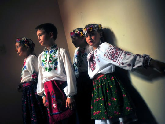 Young members of the Iskra Dance Academy wait backstage for their chance to perform at the fifth annual fall festival hosted by the Ukrainian American Cultural Center in Whippany on Saturday.
