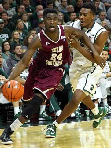 Texas Southern Tigers guard Nevin Johnson (24) drives