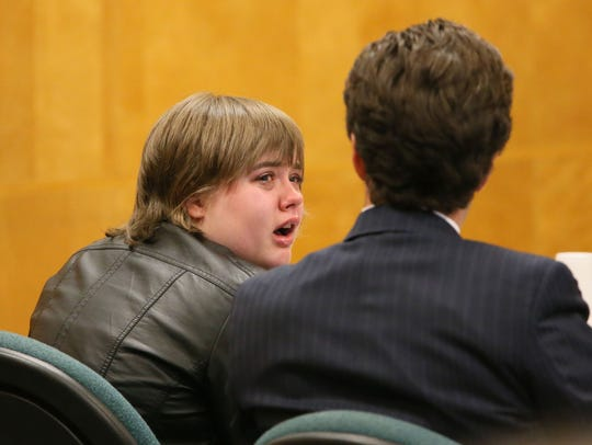 A tearful Morgan Geyser looks to her attorney, Anthony