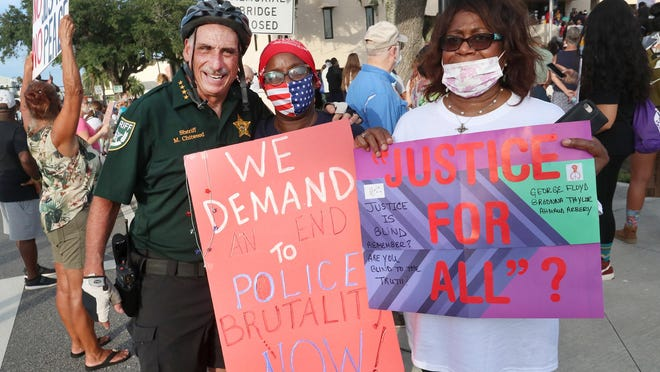 Volusia County sheriff Mike Chitwood visits with protesters at Daytona Beach City Hall, Thursday June 11, 2020 demanding justice and change following the death of George Floyd killed by a police officer in Minneapolis.