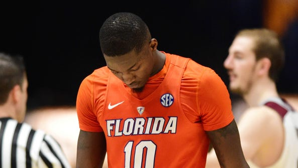 Florida Gators forward Dorian Finney-Smith (10) reacts