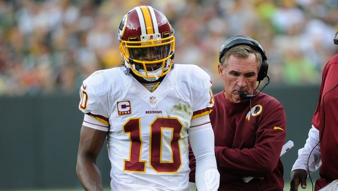 Washington Redskins quarterback Robert Griffin III and head coach Mike Shanahan walk to the sidelines during the game against Green Bay Packers on Sept. 15.