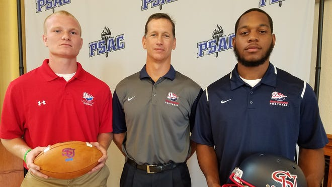Shippensburg University quarterback Ryan Zapoticky, left, and linebacker Allen Holman, right, pose with Raiders coach Mark 'Mac' Maciejewski at PSAC Media Day hosted by Kutztown on Monday.