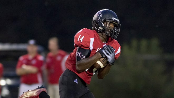 Micheal Redding (14) pulls in a pass as he takes it in for a touchdown during the Tate vs West Florida high school football at Woodham Middle School in Pensacola on Friday, September 1, 2017.