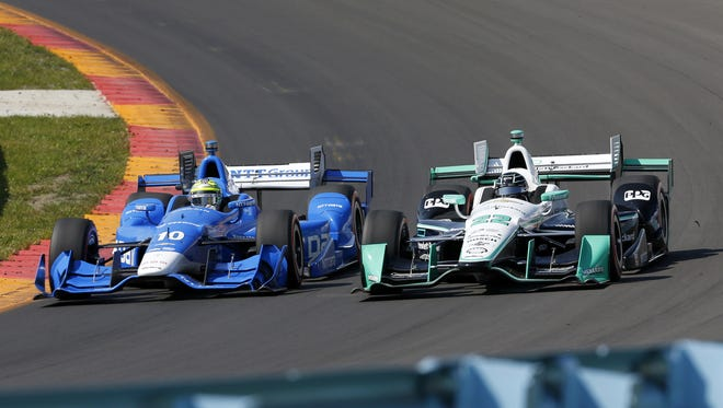 Simon Pagenaud (right) battles with Tony Kanaan during the IndyCar Grand Prix at The Glen Sunday at Watkins Glen International.
