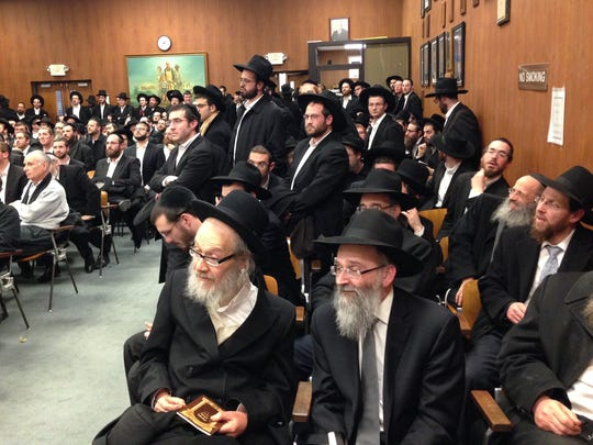 Members and supporters of the Bais Hora'ah kollel, or men's study group, packed the Lakewood municipal building March 21, 2016. The Planning Board voted to approve a change of use to allow the kollel to return to its building downtown.
