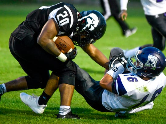 South Side's AUSTIN CLARK (20) shakes off Ripley's Gage Barham (16) after twisting him around his helmet in a TSSAA football game between South Side High School and Ripley High School at South Side High School in Jackson, Tenn., on Friday, Aug. 17, 2018.