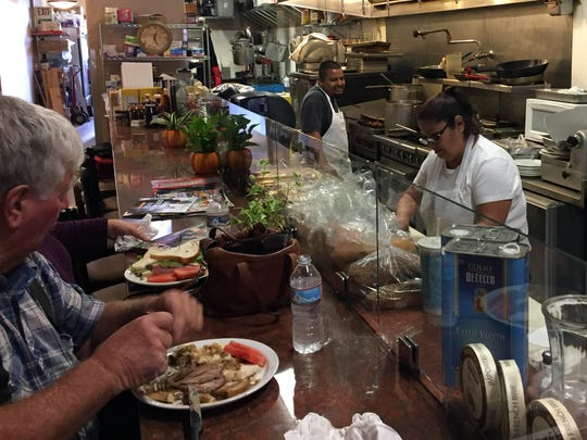 Diners sit at the newly constructed counter at Gordon's Café in Oldtown Salinas
