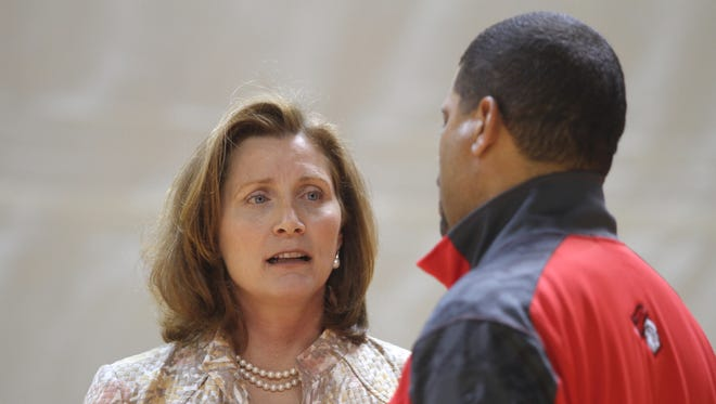 Rutgers athletic director Julie Hermann, speaking with men's basketball coach Eddie Jordan, was fired in the middle of the women's soccer team's postseason run.