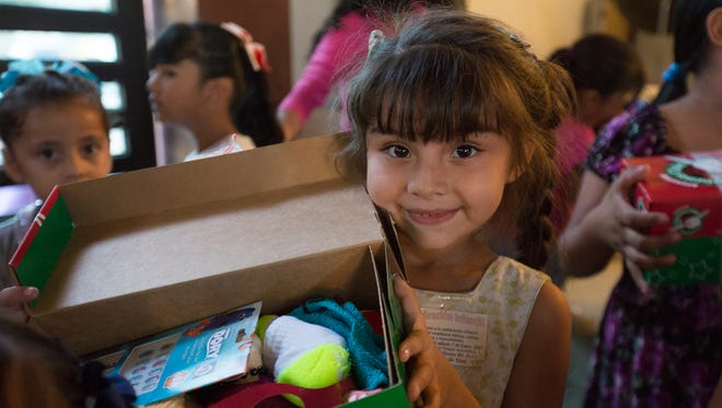 A child in Mazatlan, Mexico, receives shoebox from Samaritan's Purse.