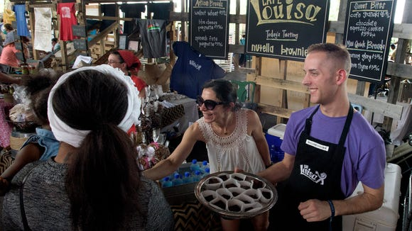 Cafe Louisa hands out samples at the Southern Makers event held at the Union Station Train Shed in Montgomery, Ala., on Saturday April 30, 2016.