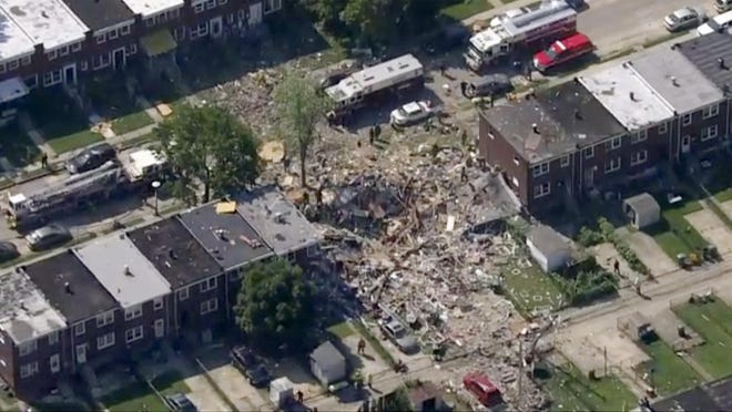 This photo provided by WJLA-TV shows the scene of an explosion in Baltimore on Monday, Aug. 10, 2020. Baltimore firefighters say an explosion has leveled several homes in the city.