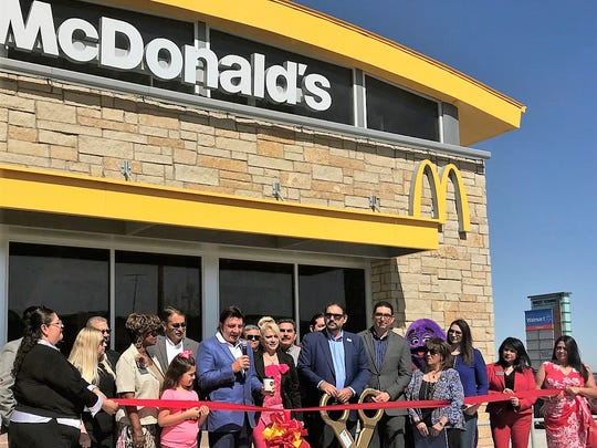 El Pasoan Richard Castro, center with microphone, speaks at the May 16 grand opening of his 27th McDonald's franchise in the new West Towne Marketplace in West El Paso.