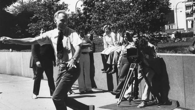"William Hudnut demonstrates his ""Hudnut Hook"" during filming of a 30-second television commercial for the Indianapolis Clean City Committee, July 3, 1977."