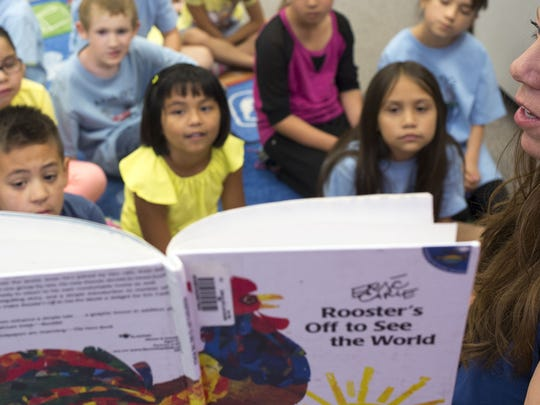 Lara Morris (Media Specialist, right) reads to a first grade class during story time, April 24, 2015, in the Estrella Mountain Elementary School library, 10301 S. San Miguel Drive, Goodyear.