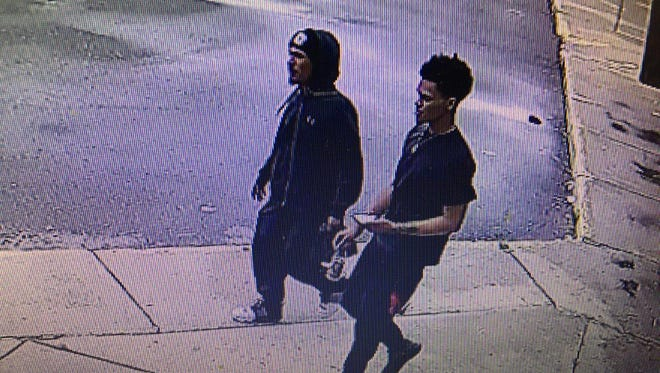 This is one of the surveillance photos of two of the shooting suspects.