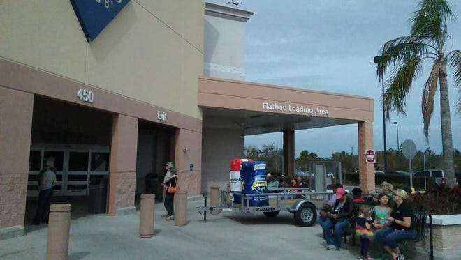 Customers wait outside Sam's Club in Cocoa after the store was evacuated Saturday afternoon.