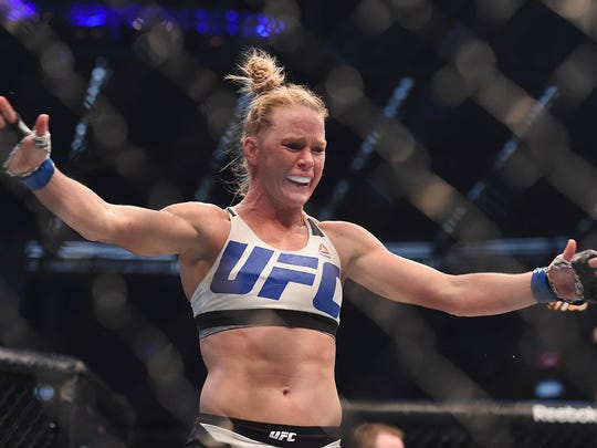 Holly Holm celebrates after defeating Ronda Rousey