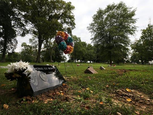The grave of Michael Brown in St. Peters Cemetery in Normandy as seen on Tuesday, Aug. 9, 2016. August 9th marks the second anniversary of Brown's fatal shooting by Ferguson police officer Darren Wilson. Brown's death sparked local protests that spread around the world and breathed live into the Black Lives Matter movement. A St. Louis County grand jury and an investigation by the Department of Justice found that Wilson was justified in shooting Michael Brown. Many in the community are still not satisfied that justice was served.