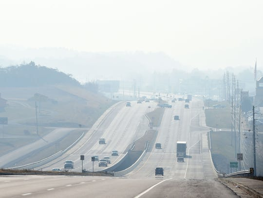 A haze hangs over the Parkway in Pigeon Forge on Tuesday,