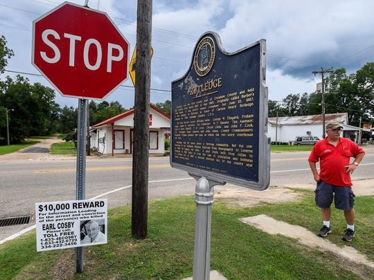 Rutledge, Ala., Mayor Steve Phillips stands on Highway 10 in Rutledge on Thursday August 10, 2017. Signs offering a $10,000 reward for information leading to the arrest and conviction of the persons responsible for the murder of Earl Cosby are posted throughout the town.