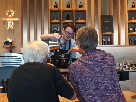 A.J. Gardilla brews coffee for customers at the new Starbucks Reserve in Palm Springs, November 17, 2017.