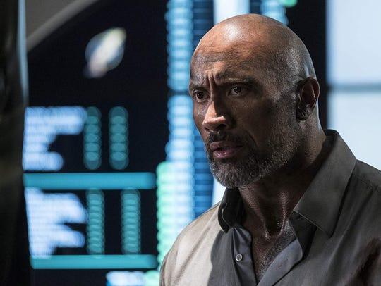 "Dwayne Johnson stars in ""Skyscraper."" The movie opens"
