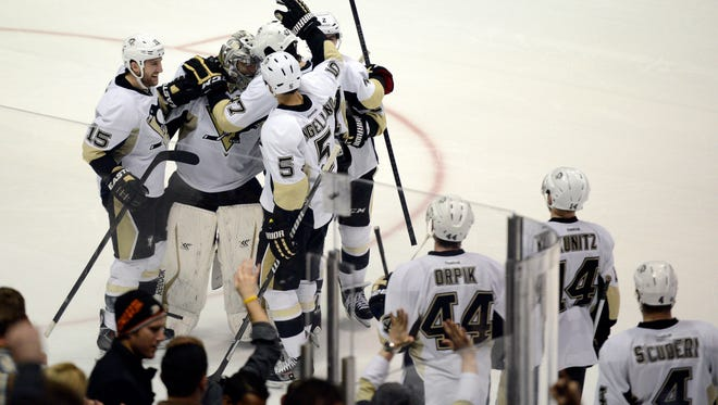 Pittsburgh Penguins goalie Marc-Andre Fleury celebrates with his team after blocking a shot during the shootout against the Anaheim Ducks at Honda Center.