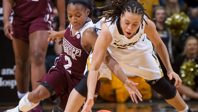 Missouri's Juanita Robinson, right, and Mississippi State's Morgan William scramble for a loose ball Thursday in Columbia, Missouri. Morgan hopes to lead a rebound performance against Ole Miss on Monday.