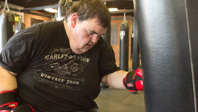 Pinckney resident Karl Burr feels motivated now that he's tackling a food addiction and working out regularly at Title Boxing Club in Brighton along with his mom. Burr plans on walking in this year's Run for the Gold 5k Run/Walk.