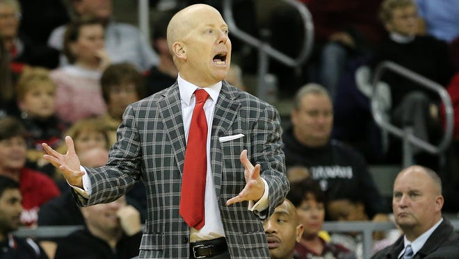 Coach Mick Cronin will send his University of Cincinnati basketball team against George Mason in the Emerald Coast Classic semifinals on Nov. 23 in Niceville, Florida.