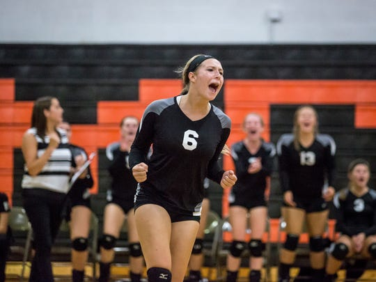 Marine City junior Jessica Wright celebrates a point during a volleyball game Tuesday, Sep. 13, 2016, at Marine City High School.