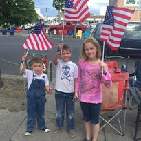 Families line the streets for the Armed Forces Torchlight Parade.