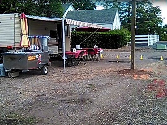 Brian Gray set up a hot dog cart and trailer at the